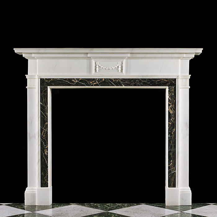 11718: A Neoclassical style white statuary antique marble chimneypiece with a deeply moulded shelf, the plain frieze centred by a central plaque decorated with a bell flower swag. The fireplace opening is bo
