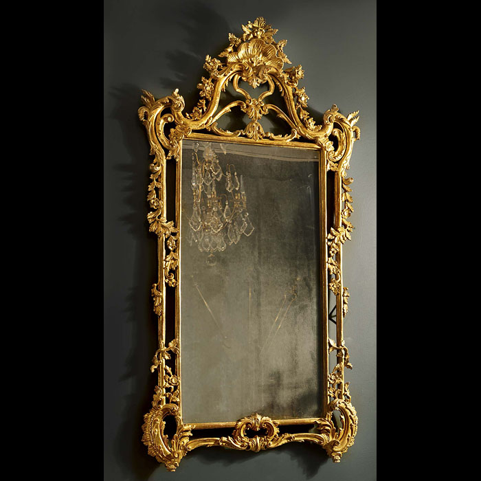 Antique English Rococo manner Giltwood Overmantle Mirror  A Giltwood Rococo Overmantle Mirror in the English style in good condition with original water gilding. 19th century.