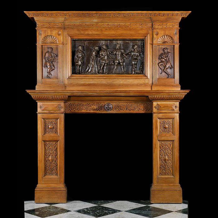 Antique carved Oak Arts and Crafts fireplace in a Tudor Gothic manner