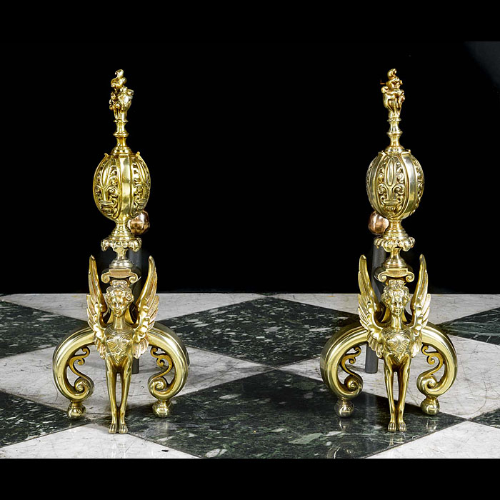 A pair of large Antique brass mythological andirons