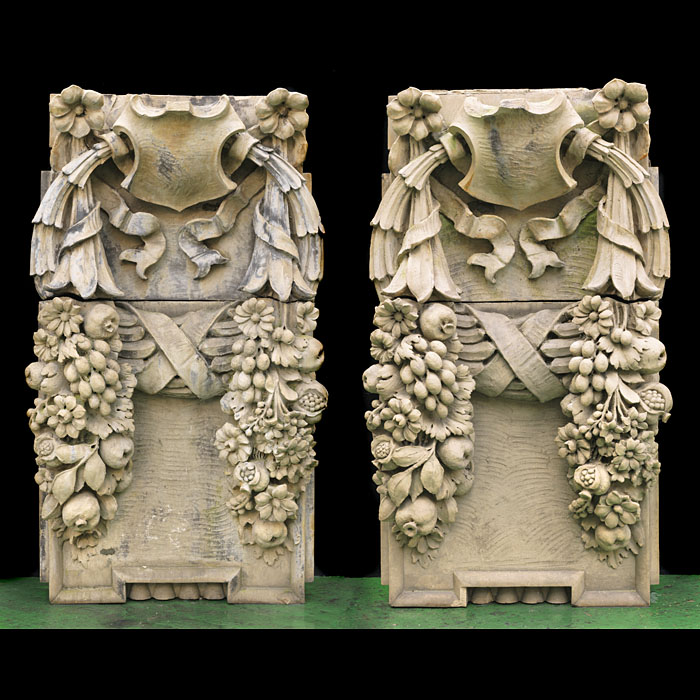 11828: One pair of three pairs, with SNos 11829 & 11826, of elaborately carved terracotta wall sculptures depicting scrolled cartouche each with twin cornucopia from which tumble abundant fruits and flowers.
