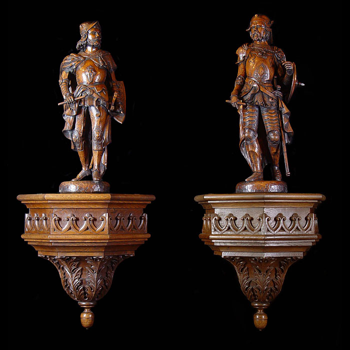 A large pair of carved oak antique warrior kings