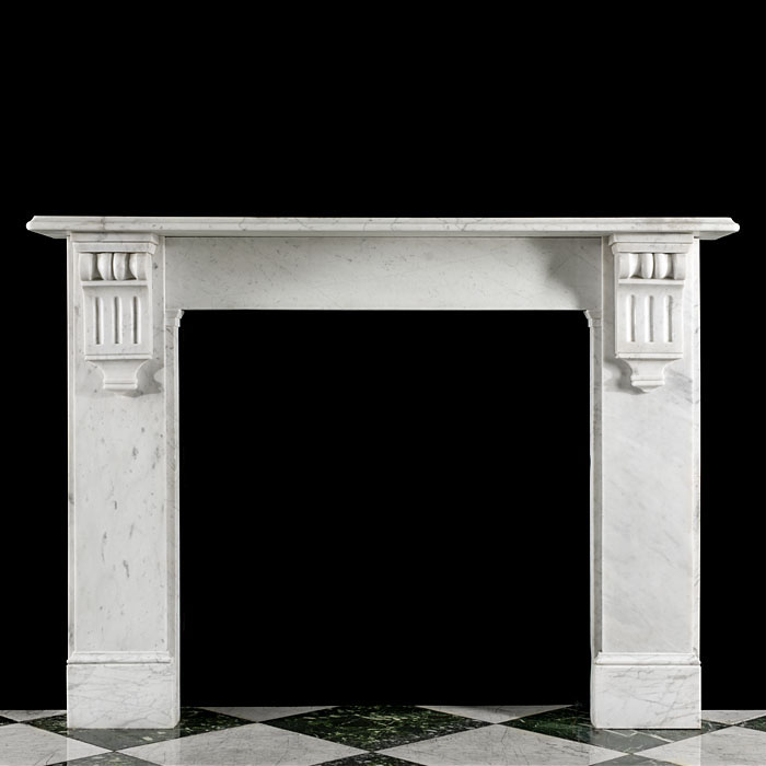 11875: A simple and restrained 19th century white Carrara Marble chimneypiece with corbelled endblocks. English, circa 1870.     Link to: Antique Victorian, William IV, Arts and Crafts, Aesthetic, Art Nouvea