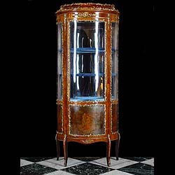 A Louis XV Rococo style Vitrine in Glass and Gilt metal