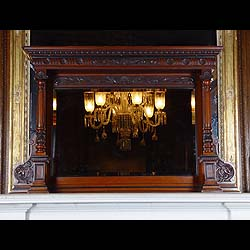 Antique Mahogany Overmantel with columns and Acanthus detail and central Mirror