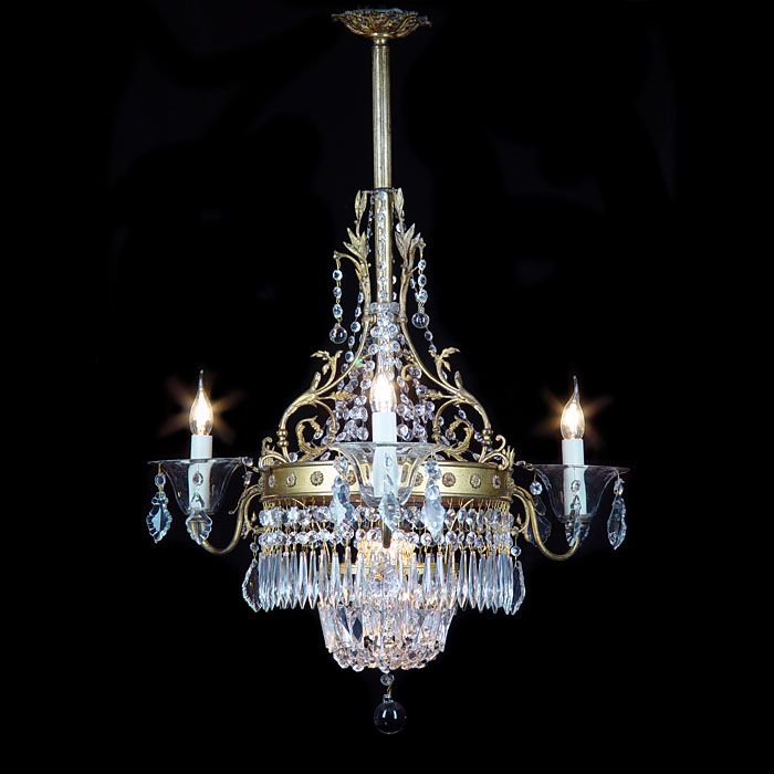 A 20th century Regency style four branch crystal chandelier