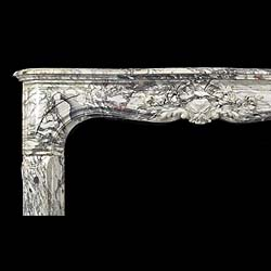 A fine and richly carved Louis XV Breche Violette Antique marble Cheminee Fireplace