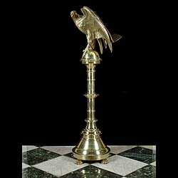 Antique Brass Victorian Lectern with Eagle and Inscription  This solid Brass Victorian Lectern is adorned with an Eagle with spread wings, while its talons are wrapped around a half orb. The column plinth is inscribed. From St James Chuch.