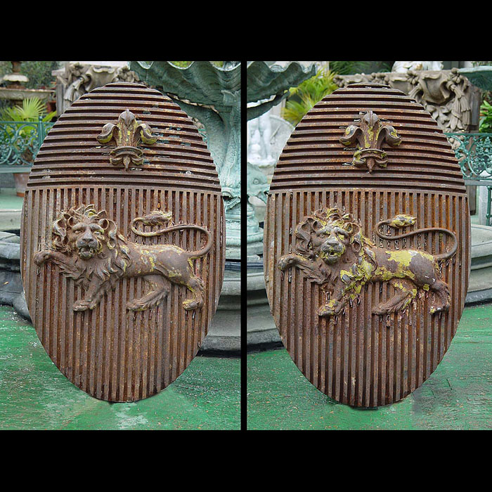 11982: MASSIVE & EXTRAORDINARY OVAL CAST IRON  HERALDIC ARMORIAL CRESTS.One of two pairs with SNo 11983 this pair centred with large single lions passant in high relief, integrally cast against vertically fl
