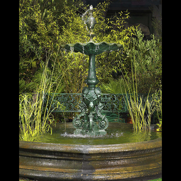 12001: A slender French mid 19th century Cast Iron Garden Fountain in the manner of the Barbezat & Cie's Foundry which in 1870 changed its name to Val d'Osne. The water is delivered from the top centre spout