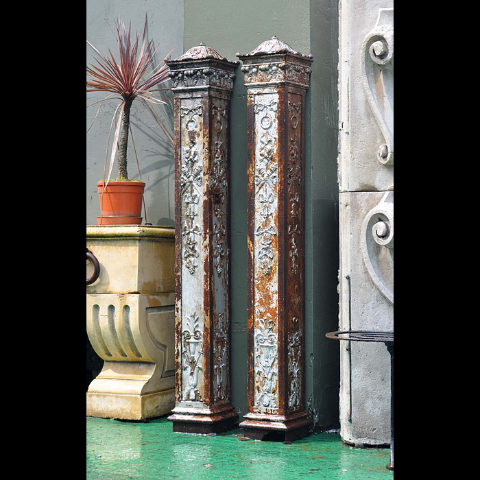 A Pair of Renaissance Style Cast Iron Posts