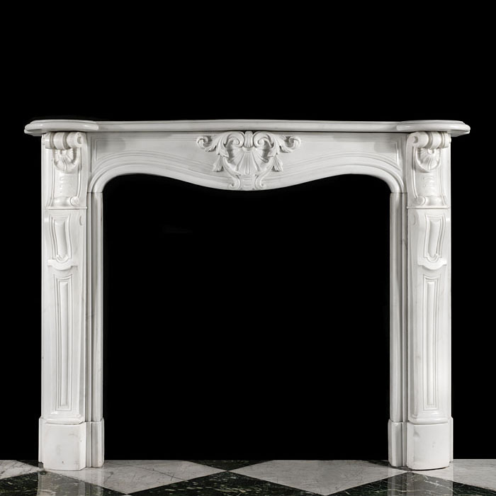 12097: A carved statuary Louis XV style chimneypiece with a stylised shell central cartouche surrounded by foliage. The scrolled shell end blocks are supported on panelled jambs.  French, mid to late 19th ce