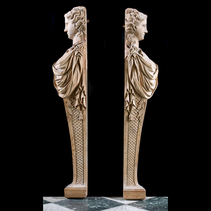 A Neoclassical pair of large, pine caryatid