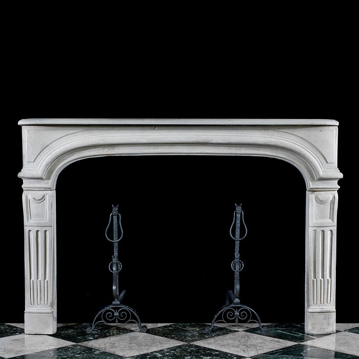 A Baroque Revival stone fireplace mantel