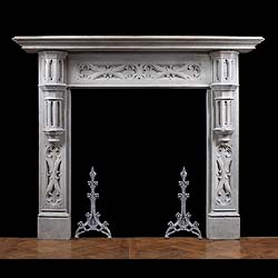 12171: A Neo Gothic composition stone chimneypiece the frieze, with bold Gothic tracery beneath a gerneous moulded shelf, is flanked by stylised turret corbels, the jambs are decorated with more bold Gothic