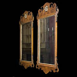 A replica pair of Chippendale style walnut wall mirrors