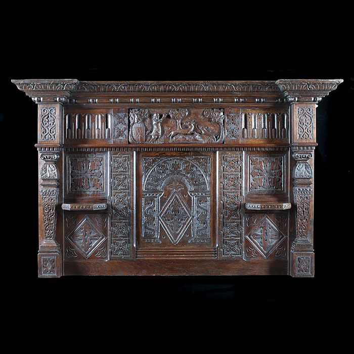 An antique Jacobean style carved oak overmantel