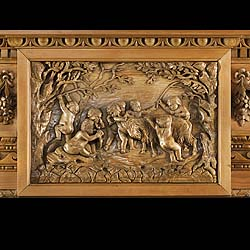 Antique Carved Pine and Limewood Fireplace in a Palladian style with decorative Putti