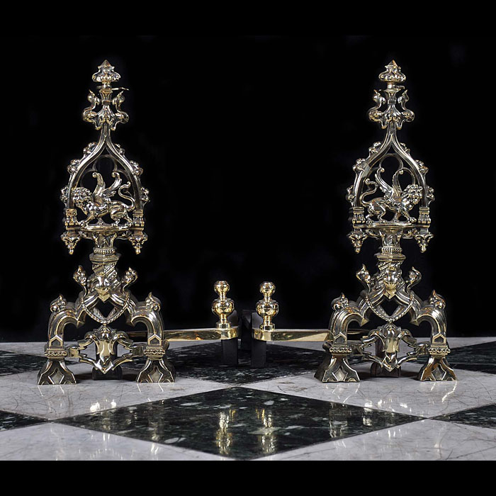 An Antique Pair of Gothic Revival brass Andirons