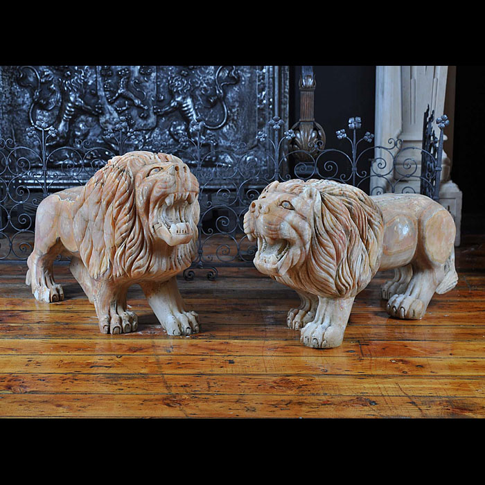 A fine pair of chalcedony lions passant