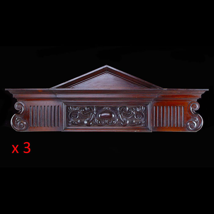12357: THREE BOLDLY CARVED MAHOGANY OVERDOORS IN THE BAROQUE MANNER, the top triangular pediment seated over the central florally carved frieze, flanked by fluted panels either  side. ENGLISH, late 19th cent