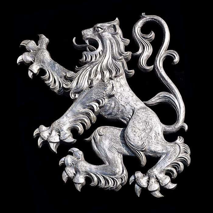 12431: A very large aluminium Lion Rampant believed to have been part of an external wall decoration removed from the external wall of an Inn. Scottish 1930s.   Notes: Casting of monuments and works of art i