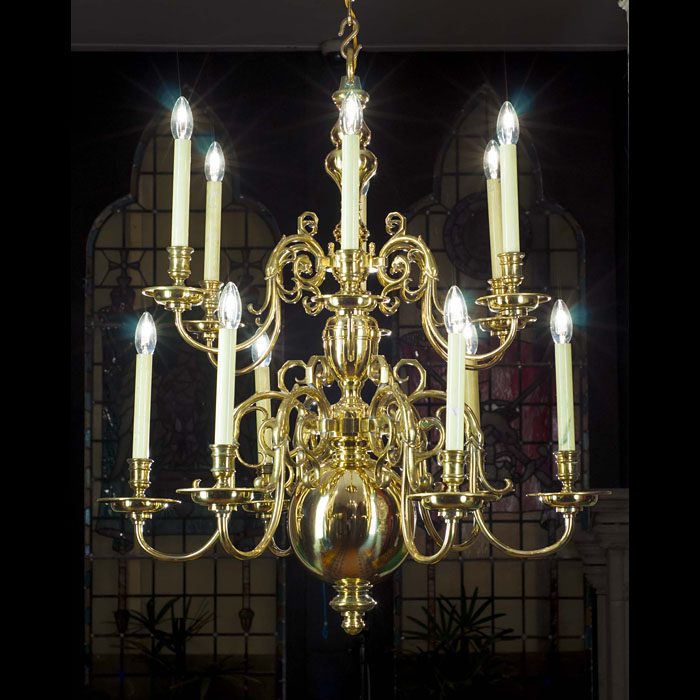 A 20th century 12 branch brass Baroque style chandelier