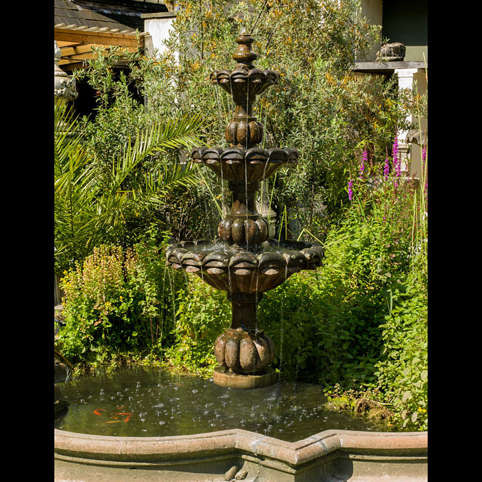 12480: In a Shady Nook by a Babbling Brook A rather fine Baroque style three tier garden fountain carved in patinated Doddington Sandstone. The three strongly carved ascending bowls eachrest on ornate and st