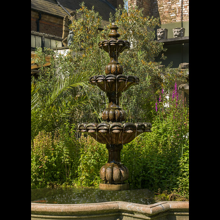 An Antique French Baroque red sandstone fountain