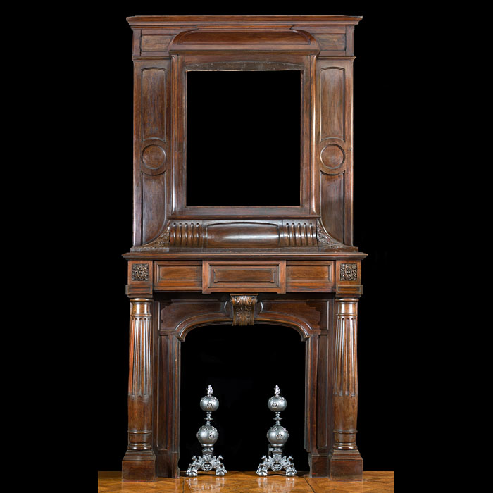 12493: A tall 19th century walnut chimneypiece and overmantel in the French Renaissance  Revival manner.The panelled overmantel shown without a painting or tapestry in the space provided. The upper frieze fl