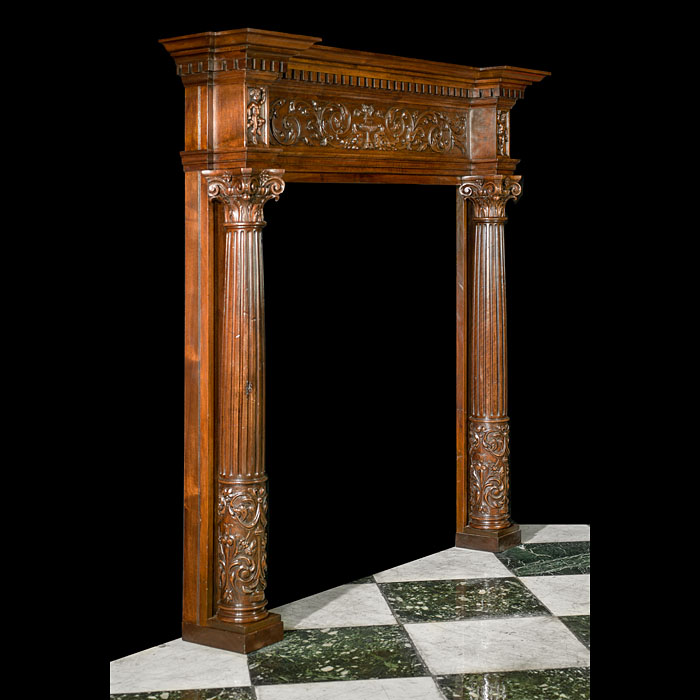 A Renaissance style antique carved walnut fireplace mantel