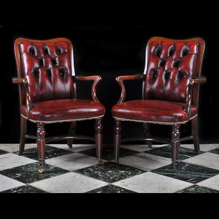 A pair of William IV style armchairs