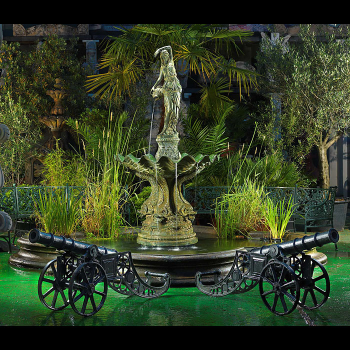 A Baroque style patinated bronze fountain