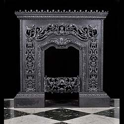 A small elaborately detailed Italian Renaissance style Antique Fireplace Insert