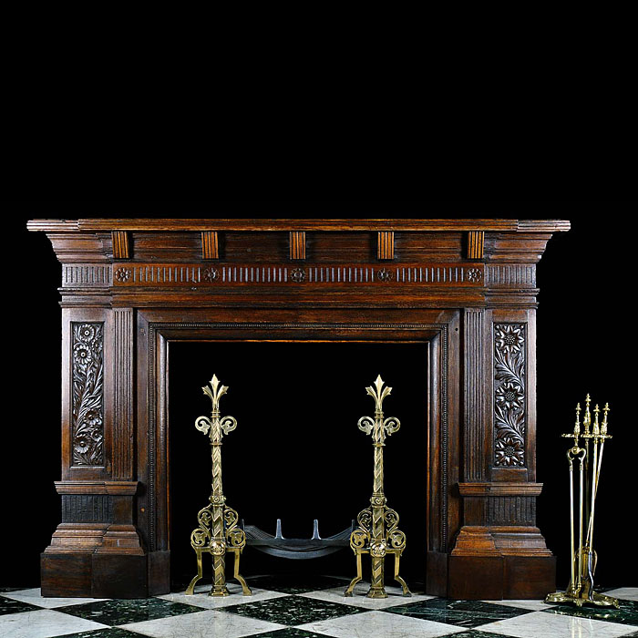 A Carved Oak Arts and Crafts style Chimneypiece