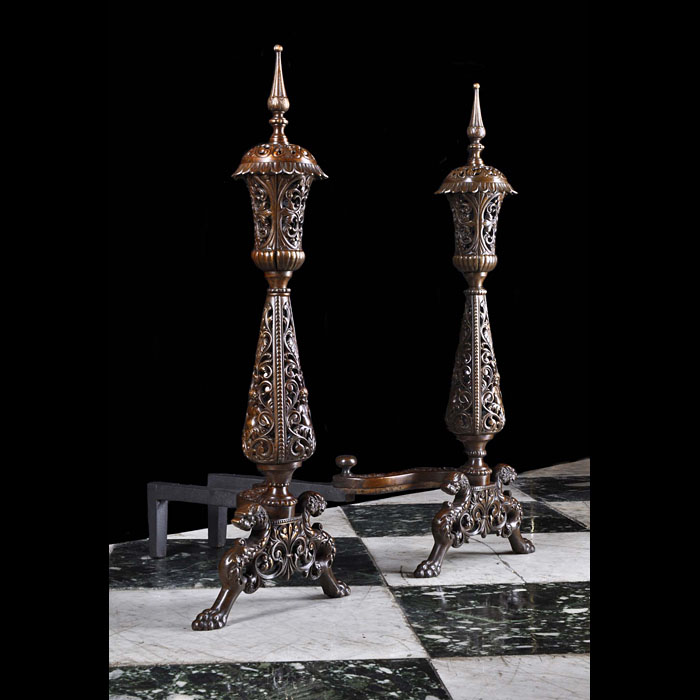 A pair of Renaissance Revival Antique bronze andirons