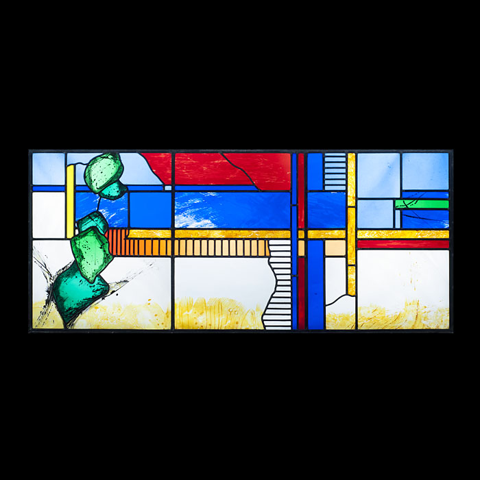 A 20th century set of three stained glass window panels