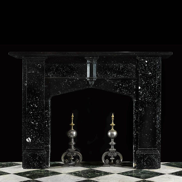 12545: AN IMPOSING VICTORIAN NEO GOTHIC CHIMNEYPIECE in Kilkenny black fossil marble There is a half hexagonal central plinth on the frieze together with the inset tracery Gothic panelled jambs supporting th