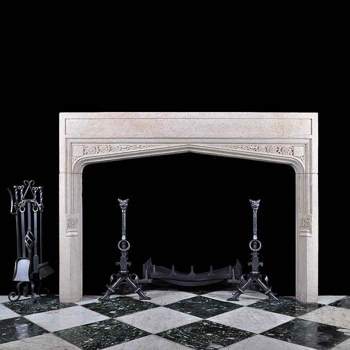 12570: A substantial Tudor Revival Derbyshire Fossil Limestone chimneypiece in the Neo-Gothic manner. The spandrels are carved with scrolled roses and shields, futher carved detail on the jambs with the date