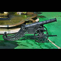 A replica pair of cast iron 17th century cannon