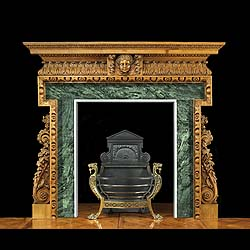 12606: A finely carved pine fireplace in the Georgian style. The oblong shelf is carved with acanthus leaf decoration with the central tablet carved in high relief with a swagged mask, flanked by egg-and-dar