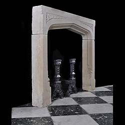 A Jacobean style antique stone fireplace surround