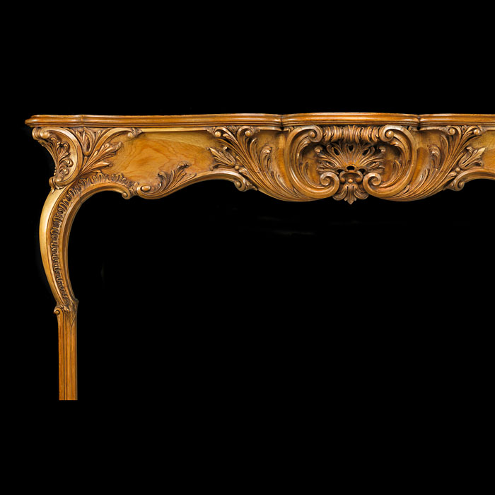 An 18th century English Rococo Fireplace Surround