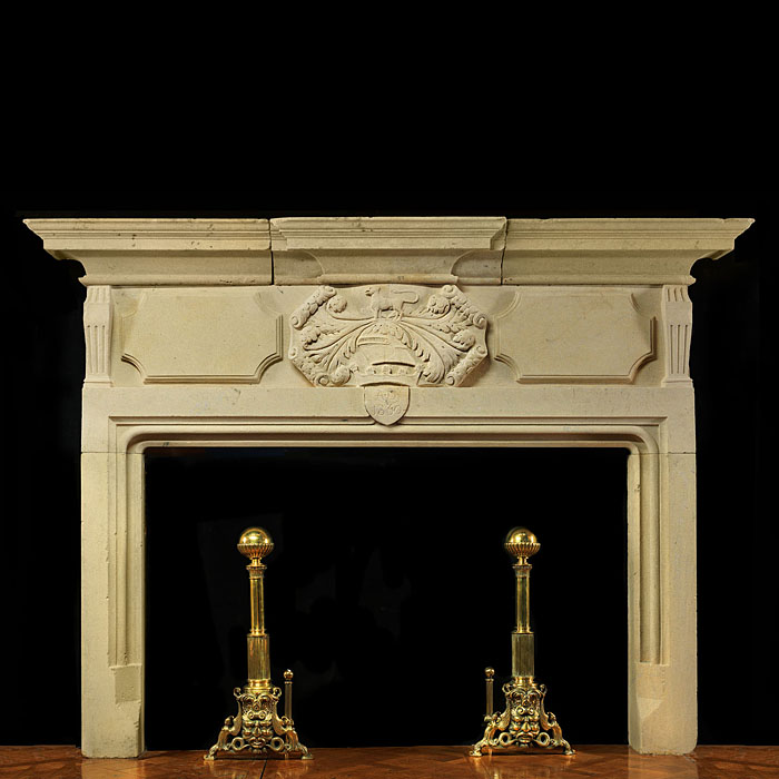 12687: HERALDIC BAROQUE:  An imposing carved Bath Stone fireplace surround and overmantel in the English Neo Baroque manner. The frieze beneath the breakfront shelf centred by a scrolled Heraldic cartouche d