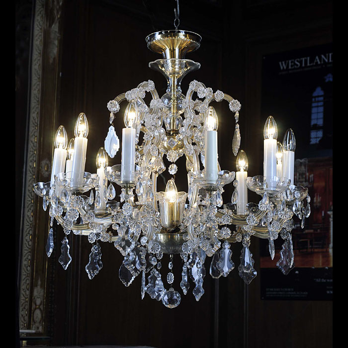 A late 20th century 2 branch crystal chandelier
