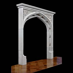 Antique Limestone Gothic Revival Chimneypiece in the Tudor manner with carved spandrels