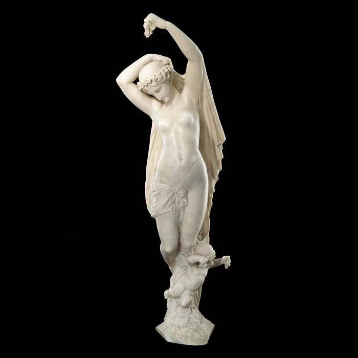 12724: A beautifully carved alabaster group in the manner of Cesare Lapini (1848 - 1890) an Italian sculptor mainly active in 19th century Florence.  A  maiden, representing Flora the Roman Goddess of Flower