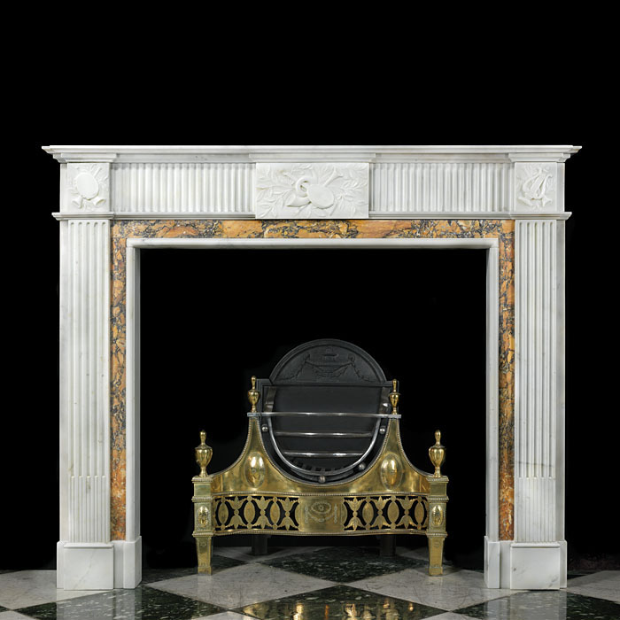 12738: An English Georgian style white statuary marble chimneypiece with Giallao di Sienna yellow marble detail, the fluted frieze with a carved central tablet depicting a lute and trumpet echoed on the end