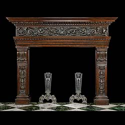 12748: A substantially built and richly carved walnut fireplace surround in the Italian Venetian manner, with birds in flight amid profusely carved floral scrolling detail on the frieze and with bold arabesq