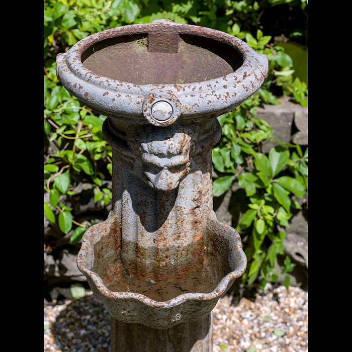 A small antique cast iron public drinking fountain